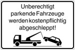 Parking sign - Unauthorized parking vehicles are towed for a fee!