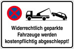 Parking sign - illegally parked vehicles are towed for a fee!