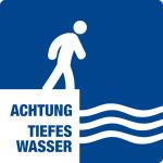 Swimming pool sign - beware of deep water